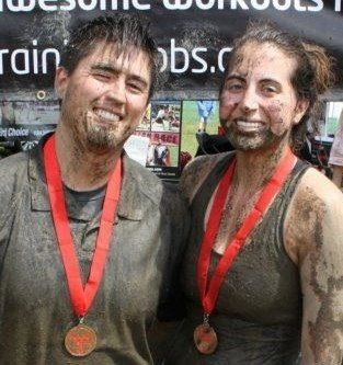 Claire and her husband Pierre after having completed the Spartan Race. (I know: crazy!)