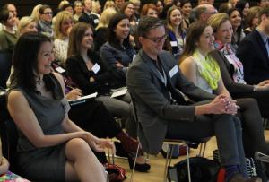 Rotman debate audience enjoying feminist humour.